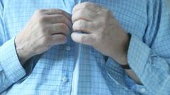 Man buttons shirt Stock Footage