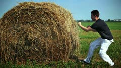 Fighting with haystack Stock Footage