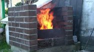 Stock Video Footage of Burning fire in outdoors fireplace 18