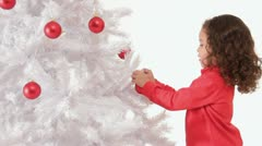 Little girl decorating christmas tree Stock Footage