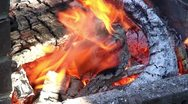 Stock Video Footage of Burning fire in outdoors fireplace 33
