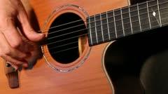Steel string guitar picking - stock footage