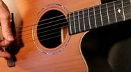 Steel string guitar player Stock Footage