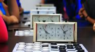Close-up of checkers game tournament with clock. Time lapse Stock Footage