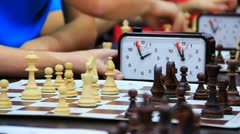 Close-up of chess game tournament with clock. Time lapse Stock Footage