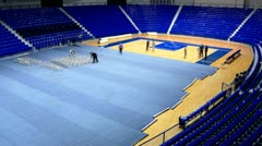 Workers put the floors surface protection at the sports hall time lapse Stock Footage