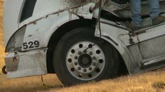 Weather, extreme wind, wrecked transport truck, zoom Stock Footage