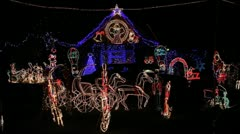 Xmas lights display in front garden of home Stock Footage