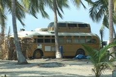 School bus camper on beach Stock Footage