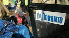 Occupy Toronto. City workers remove tents. Stock Footage