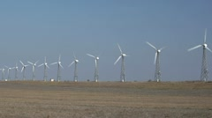 Wind turbines with approach Stock Footage