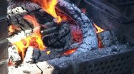 Stock Video Footage of Burning fire in outdoors fireplace 24