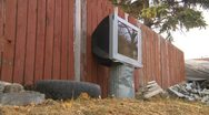 Stock Video Footage of garbage, abandoned TV, used tire and garbage in back alley