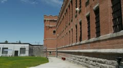 Prison Cell blcok exterior wide Stock Footage