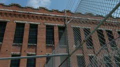 Prison cellblock exterior barbwire Stock Footage