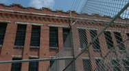 Stock Video Footage of Prison cellblock exterior barbwire