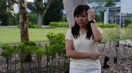 Asian girl waiting for guy on a date Stock Footage