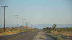Lonely road in California desert Stock Footage