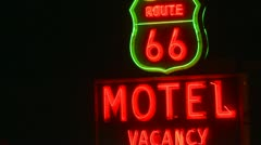 Route 66 motel sign neon night Stock Footage