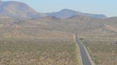 Lonely road through desert Stock Footage