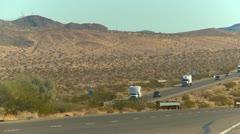 Transport trucks in the desert Stock Footage