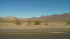 Drive plate, in the desert with traffic Stock Footage