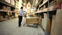 Warehouse. Man takes a box. Stock Footage