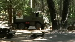 Old Army Truck in Mountain Forest Campgrounds Stock Footage