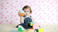Happy baby girl on the floor with toy cubes Stock Footage