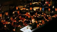 Orchestra in pew plays under direction of Evgenie Samoilov at New Opera Theatre Stock Footage