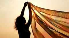 woman has hold thin shawl which waves on wind - stock footage