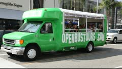 Green tour bus on the streets of  Beverly Hills - stock footage
