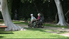 Disabled old couple on the wheelchair Stock Footage