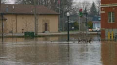 Stock Video Footage of Flood waters from the Raisin River from early December rain storms up river.