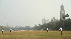 Playing cricket in the Oval Maidan, Mumbai, India Stock Footage