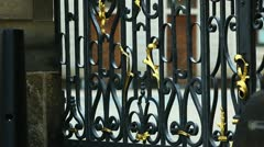 Metal fence on gate and tourist walk at background Stock Footage