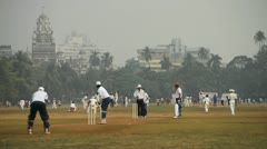 Locals playing cricket in the Oval Maidan, Mumbai, India - stock footage