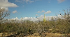 4K 30p - Winter cloud formation over mountains in the desert in time lapse Stock Footage