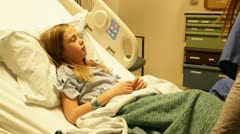 Young child in the hopital bed HD8504 Stock Footage
