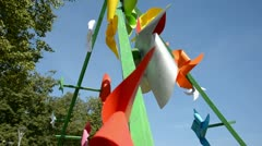 0232 happy  paper windmills on sky background Stock Footage