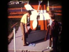 Boys playing miniature golf Stock Footage