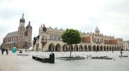Stock Video Footage of Street View of Krakow, St. Mary's Basilica, Sukiennice, Cloth Hall, Market