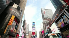 Times Square New York City wide day time tilt down traffic yellow cab cars - stock footage
