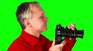 Stock Video Footage of Close-up photographer on a green screen