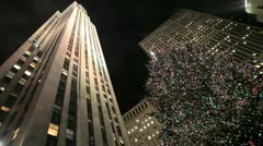 Rockefeller Center NYC Christmas holiday season winter at night low angle wide Stock Footage