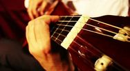 Stock Video Footage of Musician and Acoustic Guitar 10 playing wide angle