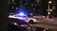 Stock Video Footage of Police car races down city street, DC, night
