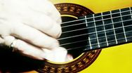 Musician and Acoustic Guitar 15 playing closeup stylized artcolored Stock Footage