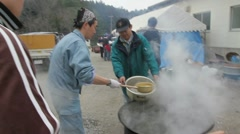 Japan Tsunami Survivors Cooking Stock Footage