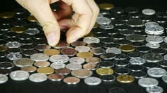 Counting golden coin from a group of money by hand. Stock Footage